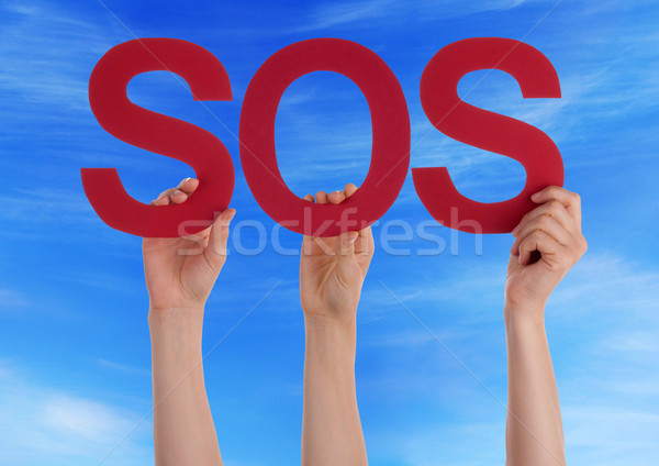 Many People Hands Holding Red Straight Word Sos Blue Sky Stock photo © Nelosa
