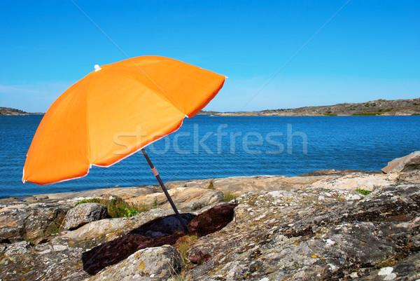 Part kék tenger narancs napernyő tengerpart Stock fotó © Nelosa