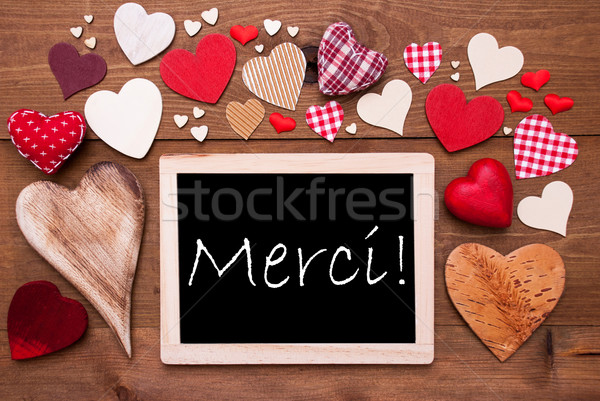 One Chalkbord, Many Red Hearts, Merci Means Thank  You Stock photo © Nelosa