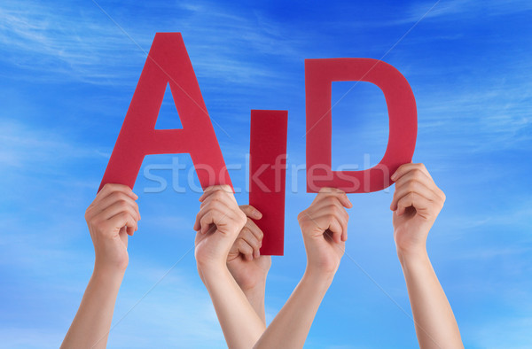 Many People Hands Holding Red Word Aid Blue Sky Stock photo © Nelosa