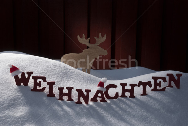 Weihnachten Means Christmas Snow Mosse Santa Hat Stock photo © Nelosa