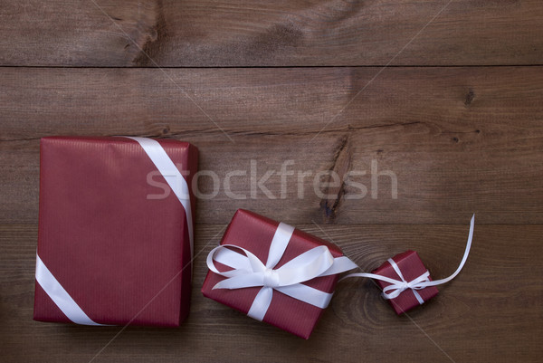 Three Red Christmas Gifts, Presents, White Ribbon, Copy Space Stock photo © Nelosa