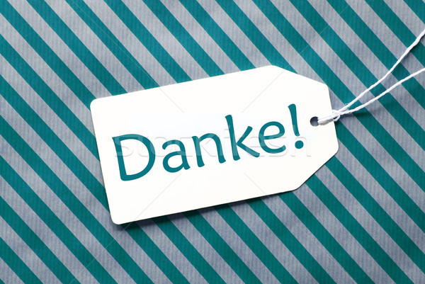 Label On Turquoise Wrapping Paper, Danke Means Thank You Stock photo © Nelosa