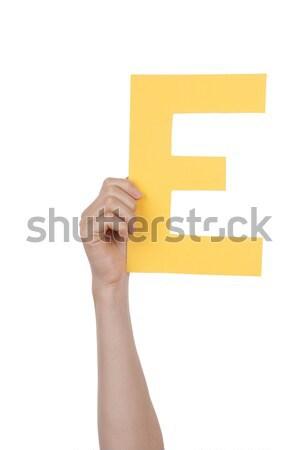 Hand With E Stock photo © Nelosa