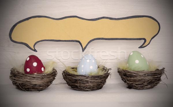 Rampenlicht drei farbenreich Ostereier Comic Sprechblase Stock foto © Nelosa