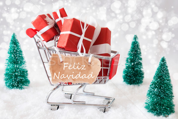 Trolly With Gifts And Snow, Feliz Navidad Means Merry Christmas Stock photo © Nelosa