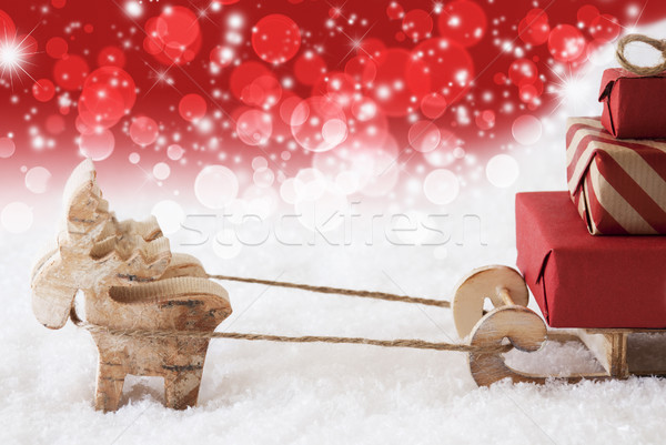 Reindeer With Sled, Copy Space, Red Stars And Bokeh Background Stock photo © Nelosa