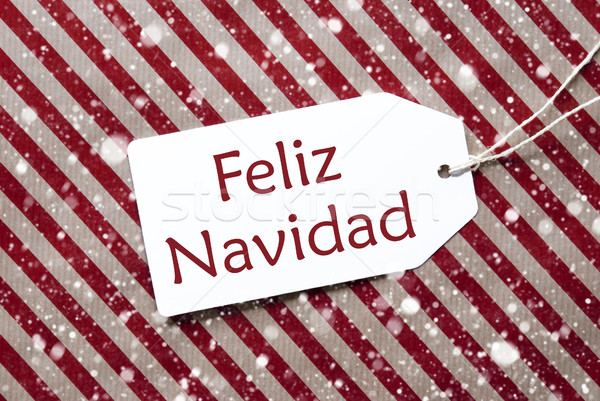 Label On Red Paper, Feliz Navidad Means Merry Christmas, Snowflakes Stock photo © Nelosa