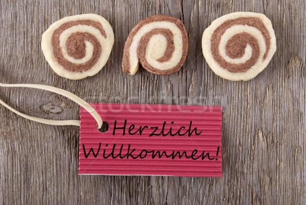 Herzlich Willkommen on a red label Stock photo © Nelosa