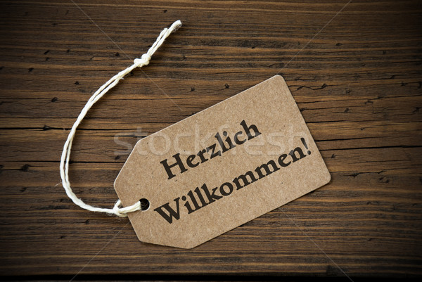 Close Up Of Label With German Text Herzlich Willkommen Stock photo © Nelosa
