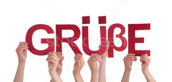 People Holding Straight German Word Gruesse Means Regards Stock photo © Nelosa