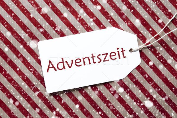 Label On Red Paper, Adventszeit Means Advent Season, Snowflakes Stock photo © Nelosa