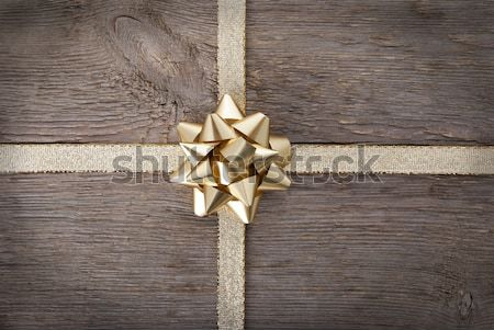 golden bow on golden ribbon Stock photo © Nelosa