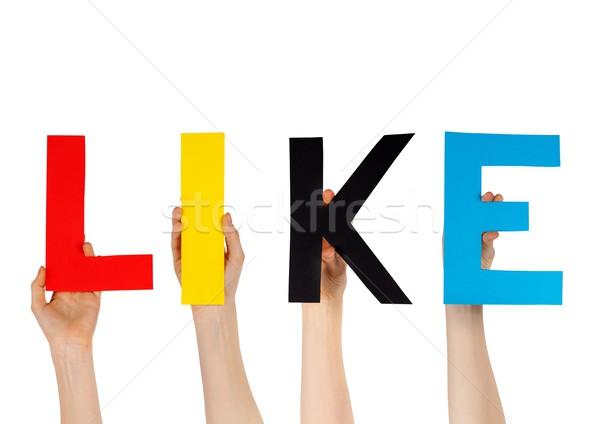 hands holding LIKE Stock photo © Nelosa