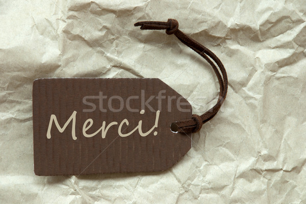 Brown Label With French Merci Means Thank You Background Stock photo © Nelosa