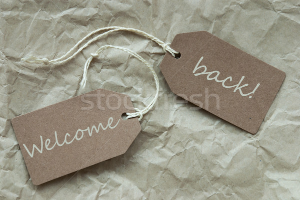 Two Beige Labels With Text Welcome Back Paper Background Stock photo © Nelosa