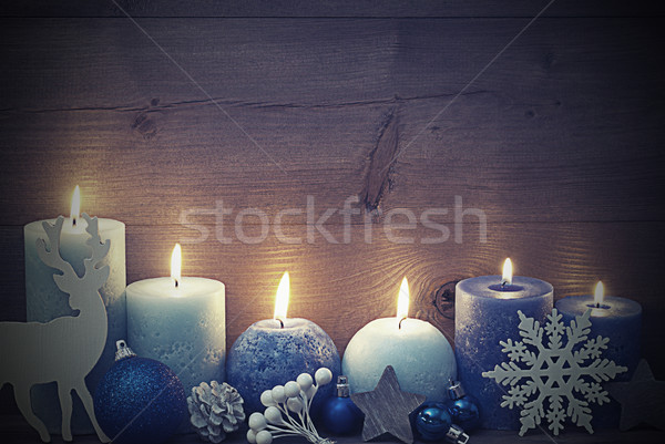 Vintage Christmas Card With Blue Candle, Reindeer, Ball By Night Stock photo © Nelosa