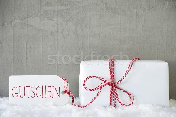 One Gift, Urban Cement Background, Text Gutschein Means Voucher Stock photo © Nelosa
