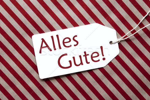 Label On Red Wrapping Paper, Alles Gute Means Best Wishes Stock photo © Nelosa