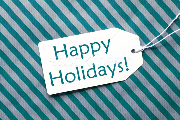 Label On Turquoise Wrapping Paper, Text Happy Holidays Stock photo © Nelosa