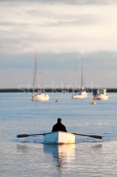 Solidão remador pôr do sol água homem barco Foto stock © nelsonart