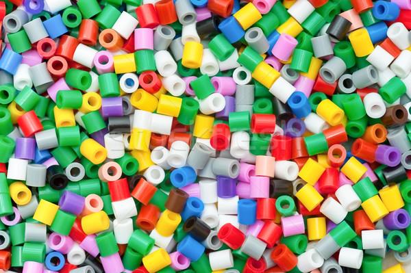 Színes műanyag gyöngyök tarka dekoratív hátterek Stock fotó © nelsonart