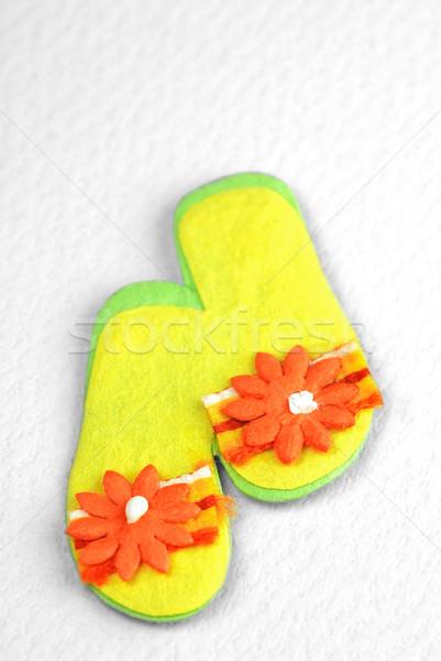 Munecas miniatura playa flores fondo naranja Foto stock © nelsonart