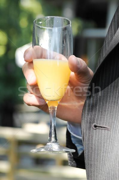 Célébration boire personne costume potable jus d'orange Photo stock © nelsonart