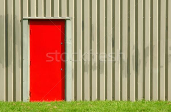 Brand uitgang Rood deuropening magazijn buitenkant Stockfoto © nelsonart