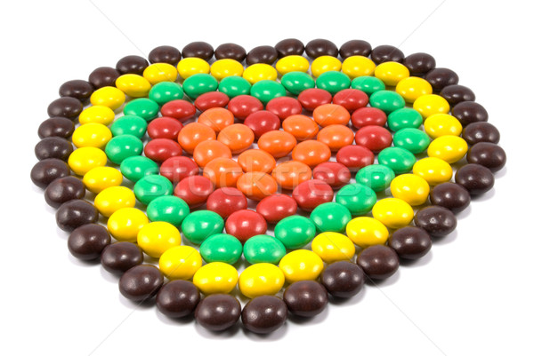 Sweets in multi-coloured chocolate glaze in the form of heart Stock photo © nemalo