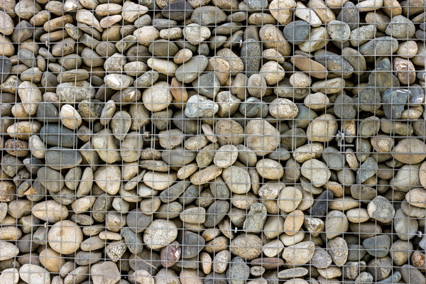 Backgrounds collection - Wall built of sea pebbles Stock photo © nemalo