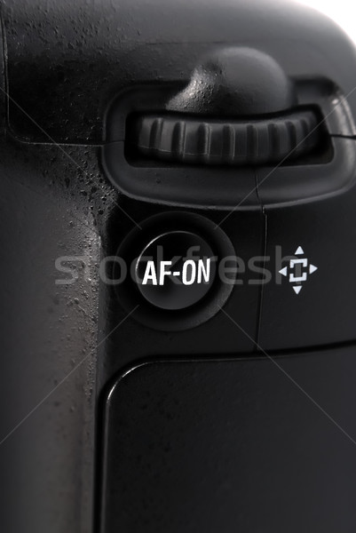 Button and joystick on the camera battery grip Stock photo © nemalo