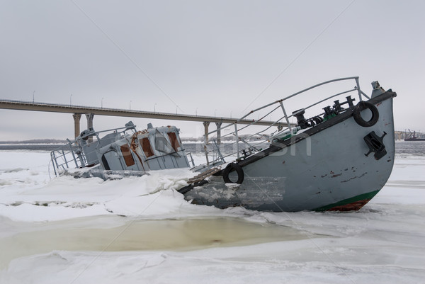 Sinking vessel in a frozen river Stock photo © nemalo