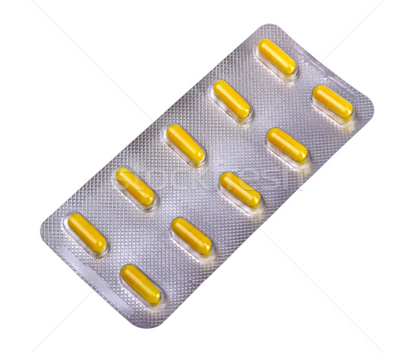 Medicine capsules packed in blisters Stock photo © nemalo