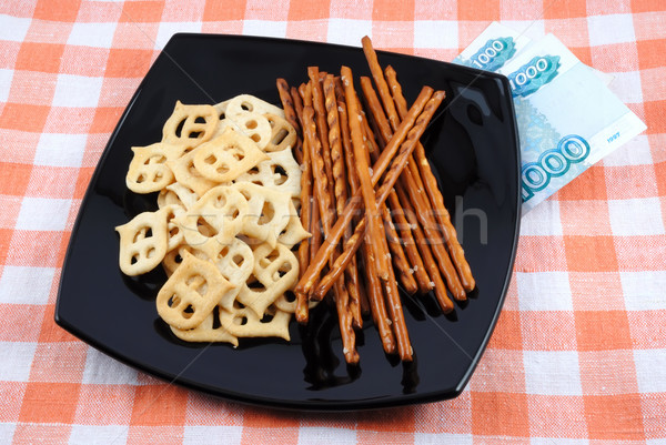 Crackers and salty sticks to beer and money Stock photo © nemalo