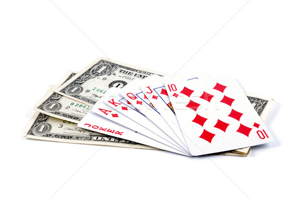 Three denominations on one dollar and playing cards Stock photo © nemalo