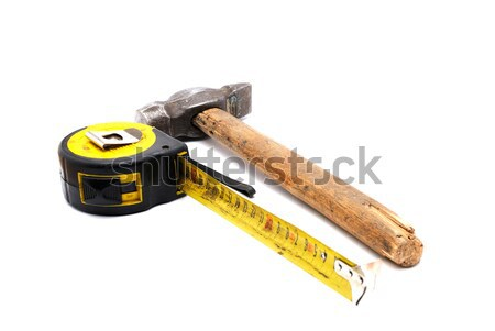 Work tool series: Old tape measure and hammer Stock photo © nemalo