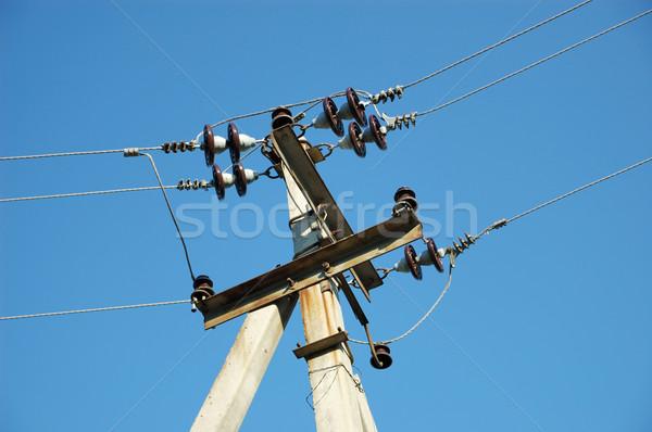Ferro-concrete column with electric wires. Stock photo © nemalo