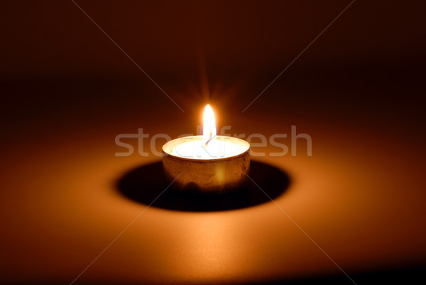 Burning candle in darkness Stock photo © nemalo