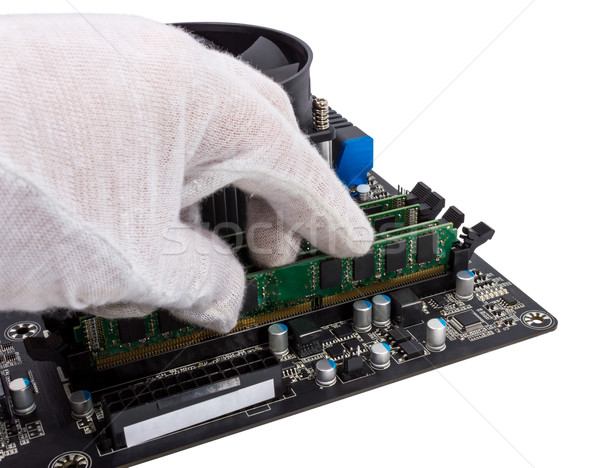 Electronic collection - Installing memory module in DIMM slot on Stock photo © nemalo