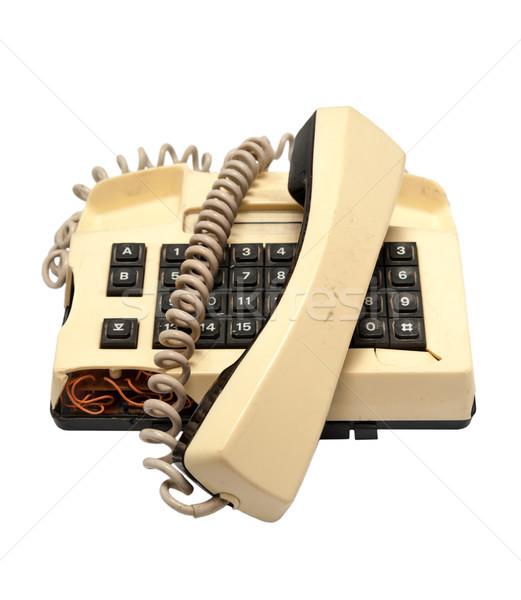 Telephone collection - crashed phone on white background Stock photo © nemalo
