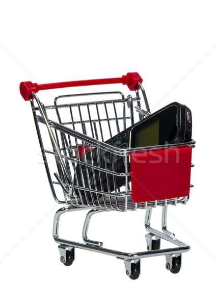 Winkelwagen mobiele telefoon geïsoleerd witte winkelen mobiele Stockfoto © nemalo