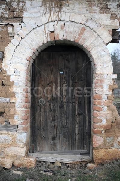 grunge background texture of demolished building showing scarred walls and door Stock photo © nemar974