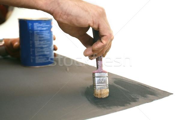 worker smearing glue with brush Stock photo © nemar974