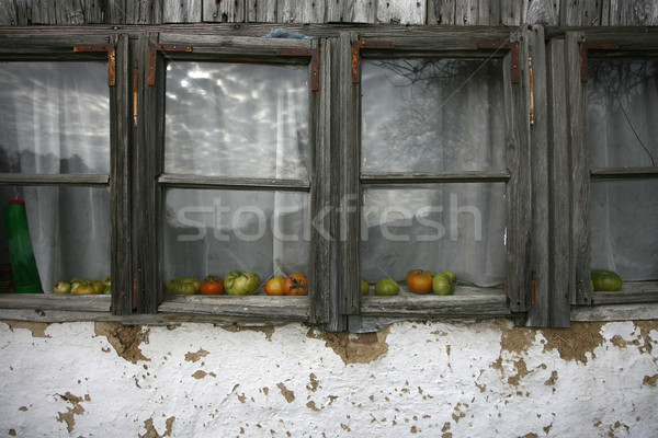 Old wooden house detail close-up, tomato on window sill Stock photo © nemar974