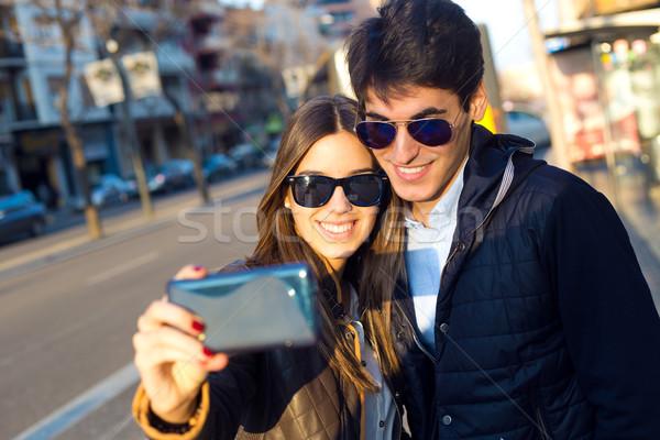 Happy young couple taking selfies with smartphone. Stock photo © nenetus
