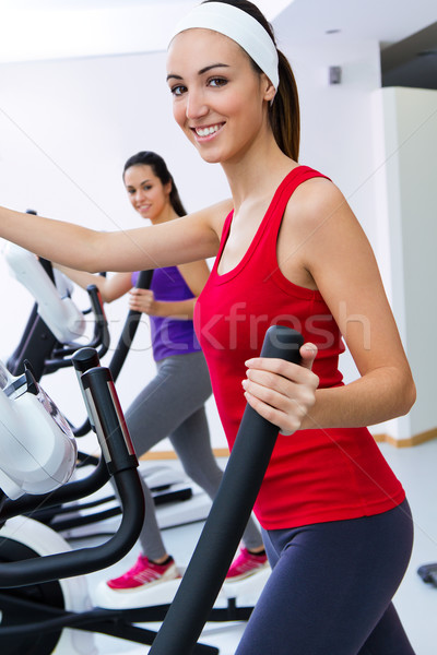 Young people with elliptic machine in the gym Stock photo © nenetus