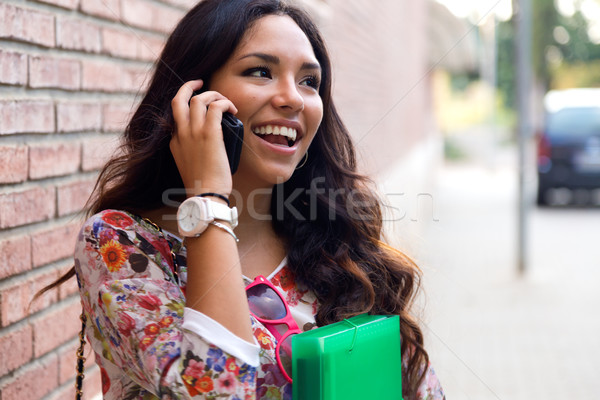 Pretty student girl talking on the phone. Stock photo © nenetus