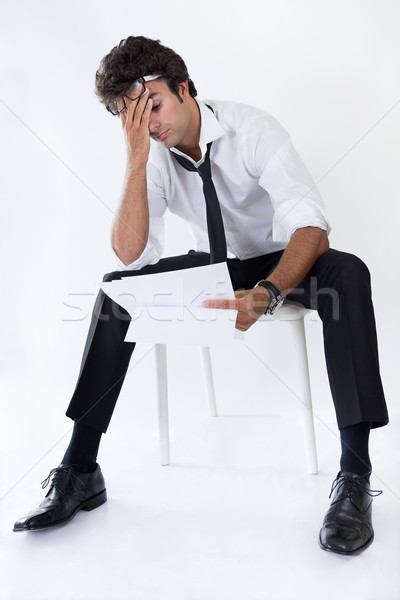 Yürütme kötü haber genç oturma sandalye adam Stok fotoğraf © nenetus