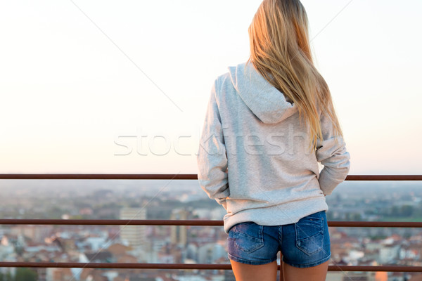 Beautiful blonde stands on the edge of the roof. Stock photo © nenetus